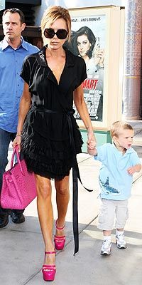 The only way I would expect her to show up at a little boy's birthday party...in a black Marc Jacobs dress, hot pink Versace platforms, a matching Hermes bag and of course dVb shades. P.S. She was attending Gwen Stefani's son's birthday party!