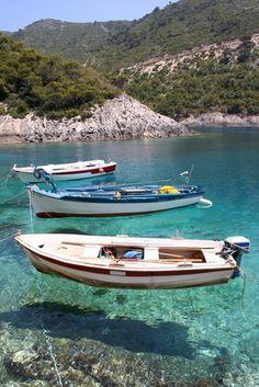 Boats aqua green clear sea