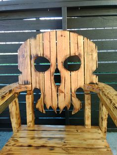 A really cool chair for the mancave! I made this piece out of pine. I torched the wood and stained it colonial maple. It was sealed with 4 coats of poly! What do you think?