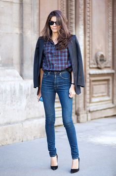 Dark washed jeans, plaid top, and black blazer