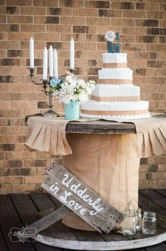 Wooden reel repurposed into a unique wedding cake display table. Donna Dodson Canton, Texas