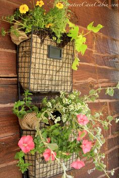 Creative Gardening...wire file organizers, burlap, & blooming flowers.