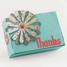 Quick Decorated Gift Box -   Create a snazzy gift box with a few quick steps. Use a die-cutting tool or purchase words and designs. Adhere one flower cutout on top of another and use a brad for the flower center. Attach the flower to a plain gift box. Add other designs and salutations.