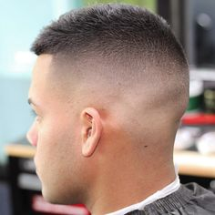 High fade haircuts cut hair ultra short or down to the skin around the sides and back of the head. This gives the appearance of thicker hair and focuses attention to the style on top, whether Mens High Fade Haircut, High And Tight Haircut, Military Fade Haircut, Mens Fade Haircut, Haircut Short, Haircut Styles, High And Tight Fade, High Skin Fade, Hairstyles Haircuts