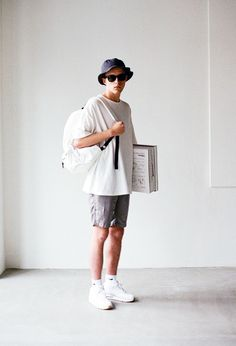 Bucket Hat, Shades, White Backpack, Grey Shorts And Triple White Air Max 90's.