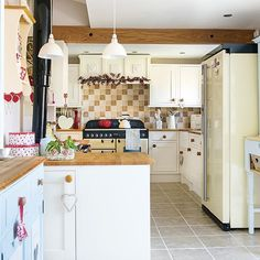 Cream country kitchen with red accents