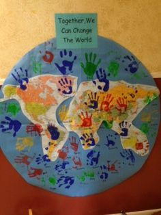 """The story of The Good Samaritan teaches how good neighbors are bold and help others.    Each neighbor's handprint illustrates hope that """"Together We Can Change the World."""""""