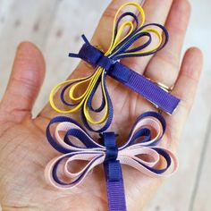 Make a dragonfly ribbon sculpture with just a bit of ribbon and a couple of stitches! Perfect for lazy days at the lake - and cute for kids.