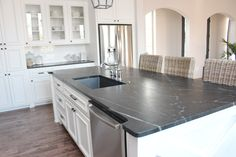 Waxed soapstone counters. I love this look, and all the lower drawers.