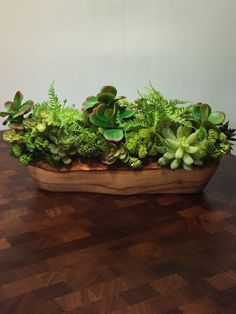 Oblong rustic-contempory wood container with lush faux succulent arrangement by bocagedesigns on Etsy