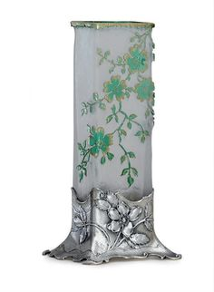 A FRENCH SILVER-MOUNTED DAUM GLASS VASE  CIRCA 1900; THE GLASS SIGNED DAUM NANCY WITH THE CROSS OF LORRAINE  Rhomboid, the acid etched glass body decorated with green and gilt apple blossoms, the silver mounts with sprays of briar rose, the silver mounts apparently unmarked 8¼ in. (21 cm.) high