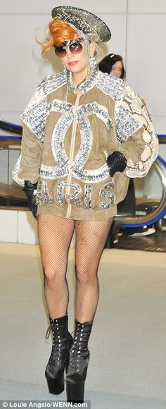 I can't help it, i love it!   Gaga in Chanel jacket and ripped fishnet tights