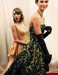 caught on camera. karlie kloss & taylor swift in Oscar de la Renta. image, Vogue MET Gala 2014.