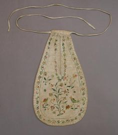 Pocket, to be tied around waist underneath your skirt.  Delicate embroidery