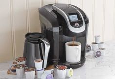 Featuring revolutionary Keurig Brewing Technology™, the brewer is designed to read the lid of each K-Cup® or K-Carafe™ pack and boasts convenient one-touch operation to perfectly brew a single-serve cup or a carafe. Coffee Brewer, Coffee Shop, Maker Labs, Coffee Maker Machine, Great Coffee, Needful Things, Small Appliances, Keurig, Cool Gadgets