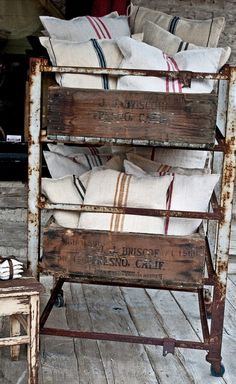 Vintage metal bakers rack with vintage fruit boxes and grain sack pillows; Like this rack, would love to use something similar for our great room to hold throws and pillows. Vintage Industrial, Industrial Chic, Vintage Metal, Industrial Design, Vintage Crates, Industrial Industry, Industrial Office, Industrial Interiors, Industrial Lighting