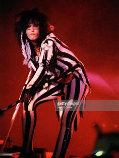 Bassist Nikki Sixx of the rock band 'Motley Crue' performs onstage at the Los Angeles Forum on August 24, 1985 in Los Angeles, California.