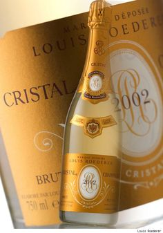 """Christian smiles, and I know that he did. He summons the waiter. """"Two bottles of the Cristal please. The 2002 if you have it."""""""