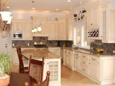 antique white cabinets with black appliances - love this color of