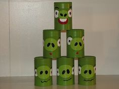 DIY angry birds game - spray paint tin cans like pigs and paint red rubber ball like bird...haha...too funny!...tutorial