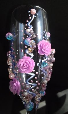 Purple Fantasy - set of 2 champagne flutes, decorated with glass beads, glass pearles and cold porceline roses....perfect for a fantasy wedding