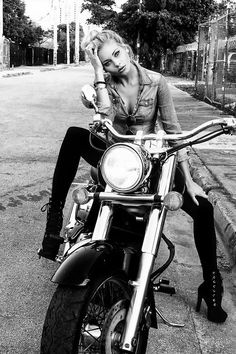 black and white picture, girl on her Harley Davidson - pretty!