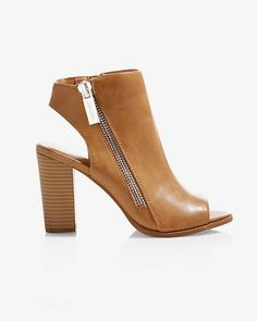 With a versatile stacked heel and elegant side zippers, these booties will enliven your summer outfits. The chic color makes it extra easy to pair this pair with everything from jeans to your cutest casual dress.