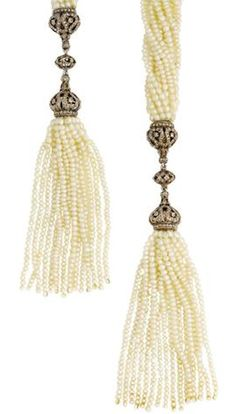A belle époque seed pearl and diamond sautoir, circa 1905 Formed of twelve rows of seed pearls with tassel terminals, each with pierced cupola surmounts set with rose-cut diamonds, length 137cm.