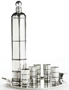 "Art Deco 1934 silver plated cocktail set made by International Silver Company. It was part of the ""International Giftware"" series and sold as a set comprised of five cups, a shaker shaker and tray."