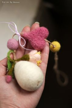 For my felted Easter Egg I used needle felted techniques and 100% pure Bulgarian wool.I dye the wool myself to achieve the right colors. My Easter Egg ornament has soft pink blossom, heart, ribbon and felted ball.  The Easter Egg will make you feel surrounded by love.Just hang it up