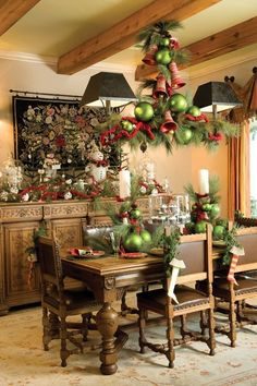 Decorate a chandelier using pine, ornaments and other Christmas elements to really make your dining room pop
