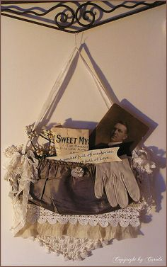 Shabby chic wall hanging from a lace trimmed vintage purse,old family photos…