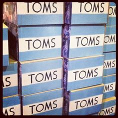 Big @TOMS shipment day! New tiny TOMS, women's classics, desert wedges and ballet flats. #blissboutiques #toms
