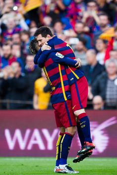 Lionel Messi (R) of FC Barcelona celebrates with his teammate Neymar Santos Jr after scoring his team's first goal during the La Liga match between FC Barcelona and Club Atletico de Madrid at Camp Nou on January 30, 2016 in Barcelona