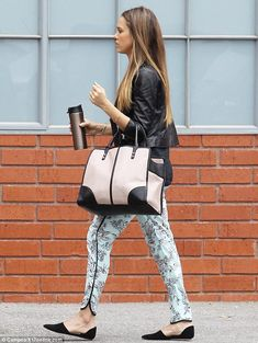 Forever stylish: Jessica Alba looked chic in her floral trousers as she headed towards her office in Los Angeles, California on Tuesday