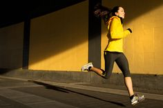 Simple bright graphic photography of woman running for Nike by sport action photographer Anthony Georgis | www.anthonygeorgis.com