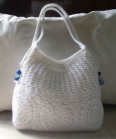 I am crocheting this lovely purse by using the photograph as my pattern guide.  It is certainly lovely!      Rope is used for the handles and side supports.  I found the instructions for these handles at this website, and the example is exactly the same configuration as needed for THIS purse.    http://www.futuregirl.com/craft_blog/archive/2008_12.aspx