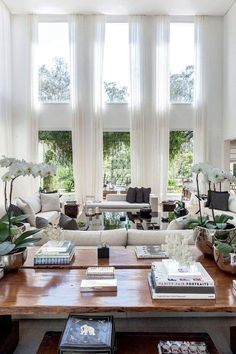 White sheer fabric on two story windows with no visible drapery hardware
