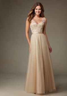 Beautiful Long Tulle Bridesmaid Dress with Embroidery and Beading with Satin Waistband Designed by Madeline Gardner. Shown in Champagne.