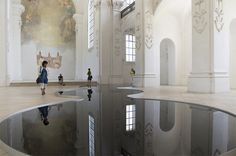 Glassy Pools of Used Motor Oil Reflect the Architectural Splendor of a Swiss Church (Created by Swiss artist Romain Crelier)