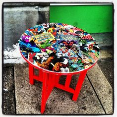 Revintaged Comic Book Side Table.  Featuring Batman, Spiderman, The Avengers, Superman, The X-Men, and more Marvel and DC.. $99.99, via Etsy.