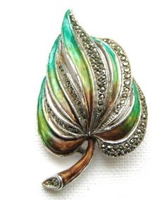 The perfect mix of understated pure beauty, this vintage leaf spray brooch, dating from the It's made from cold painted enamel work in the most glorious of green and brown colours, and encrusted with sparkling marcasites gemstones. Leaf Jewelry, Old Jewelry, Enamel Jewelry, Ethnic Jewelry, Antique Jewelry, Vintage Jewelry, Gemstone Beads, Gemstone Rings, Marcasite Jewelry