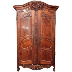 French Louis XV walnut Armoire du Marriage form a chateau in the Luberon area, 18th century. Having carved decoration in music and foliate decoration. The traditional crest with pierced apron.
