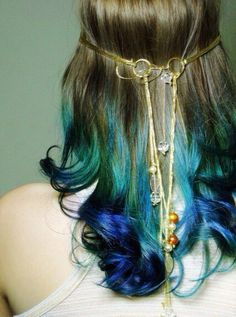 Brown shoulder length hair with blue green curls
