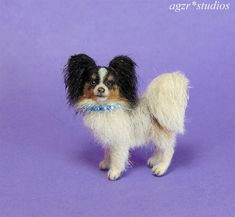 After baked, I applied a coat of natural fur layer by layer for a lifelike look. She is a scale dog. Horse Sculpture, Sculpture Clay, Papillon Dog, Miniature Dogs, Thing 1, Polymer Clay Art, Dollhouse Miniatures, Art Dolls, Fur