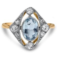 13 Aquamarine Engagement Rings That'll Sweep You Off Your Feet via Brit + Co