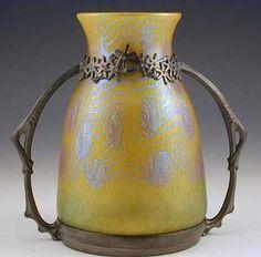 Loetz - Designer - Friedrich Adler Description - Irridescent glass vase with unpolished pewter mount by nancy