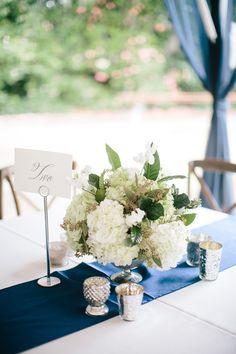pretty white centerpiece with magnolia leaves | Juliet Elizabeth #wedding