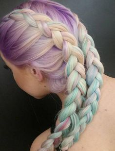fishtail braid long hairstyle with pastel hair color.