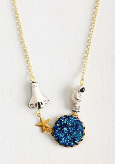 Better, Asteroid, Stronger Necklace. Be warned - wearing this gold necklace by Eclectic Eccentricity will inspire a quick trip to the planetarium! #blue #modcloth